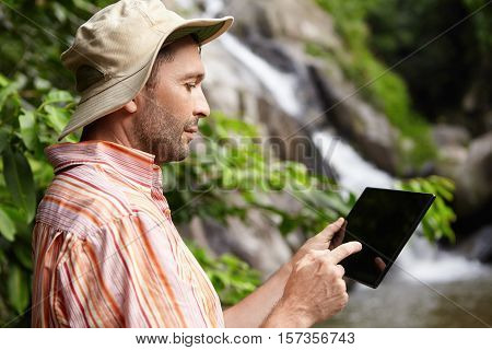 Profile Of Serious Male Scientist With Stubble Taking Picture Of Nature On His Black Generic Digital