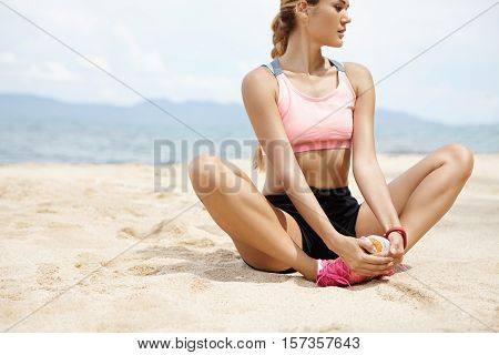 Sports, Fitness And Healthy Lifestyle. Fit Woman Runner Looking Concentrated While Stretching Legs B
