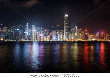 Night View Of Skyscrapers On Waterfront In Hong Kong