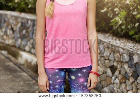 Fitness And Healthy Lifestyle Concept. Midsection Of Sporty Woman Runner In Sports Clothing Resting