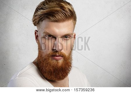 Close Up Portrait Of Fashionable Redhead Hipster Man With Fuzzy Beard And Trendy Haircut Wearing Whi
