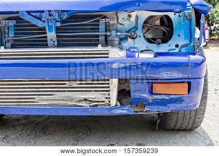 Blue Car crash damaged automobiles after collision in city