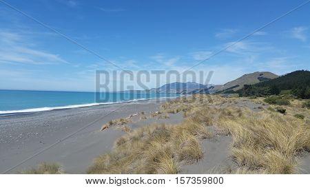 Beautiful, sunny coastal mountain scene in Kaikoura, New Zealand
