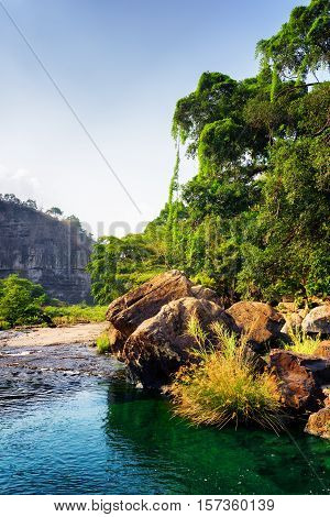River With Emerald Crystal Clear Water Among Woods And Rocks