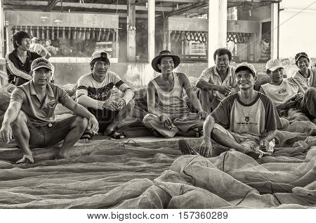 Vietnamese dockers in Nha-Trang. Vietnam, May of 2016