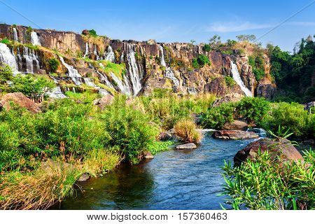 Scenic View Of Natural Cascading Waterfall With Crystal Clear Wa