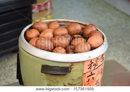 Asian street food - Eggs boiling in a pot