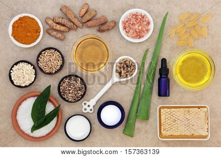 Skincare ingredients to soothe psoriasis on natural hemp paper background.