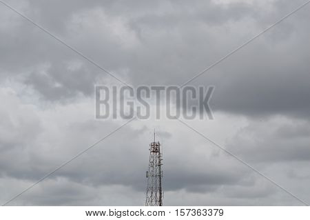 telecommunication tower in dull sky while rain coming