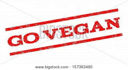 Go Vegan watermark stamp. Text caption between parallel lines with grunge design style. Rubber seal stamp with dirty texture. Vector red color ink imprint on a white background.