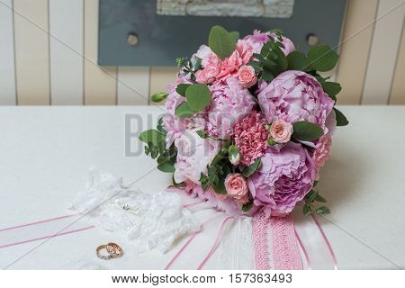 Beautiful wedding bouquet and rings flowers peonies