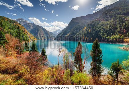 Amazing View Of The Long Lake With Azure Water Among Mountains