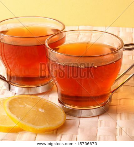 tea time - tea cups with lemon