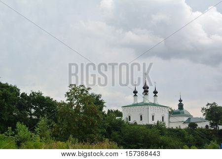 View of the Suzdal Kremlin XII century. Church of the Entry into Jerusalem and Church of the Assumption - in the center of Suzdal. Gold ring of Russia. Orthodox architecture