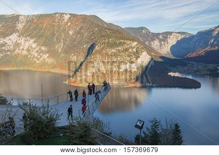 Hallstatt Austria - October 28 2016: Tourists admiring the magnificent view at the panoramic viewing platform