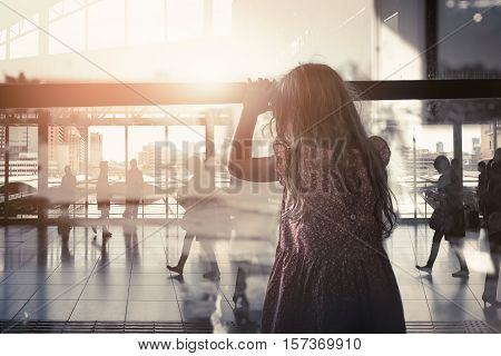 The little girl looking through the window farewell feelings alone. Dark tone color sadness emotions concept.