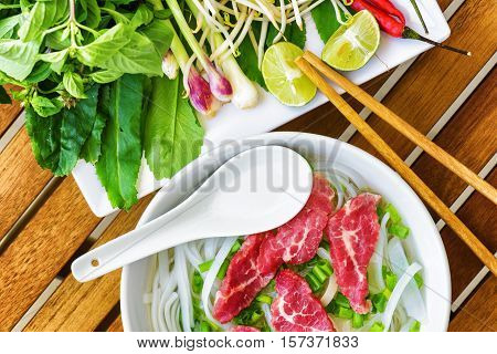 Top View Of The Pho Bo. Popular Beef Noodle Soup In Vietnam