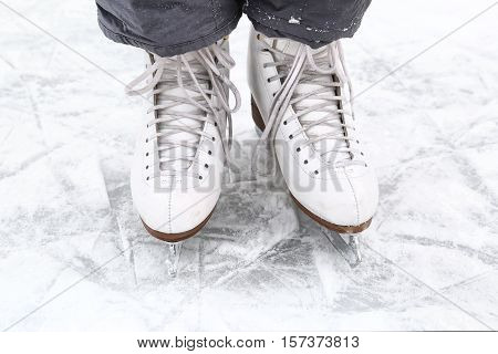ice skate boots close up photo on snowy ice rink