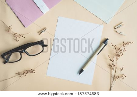 letters and dried flower in workspace with copy space with vintage filter effect