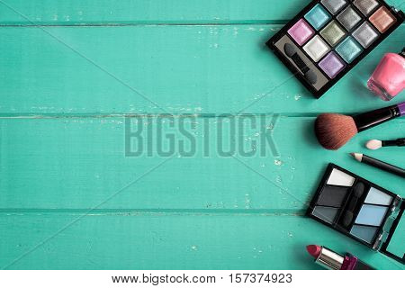make up with cosmetics and brushes on wooden background with copy space Top view