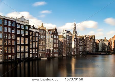 Amsterdam city view of Netherlands traditional houses with Amstel river in Amsterdam Netherlands
