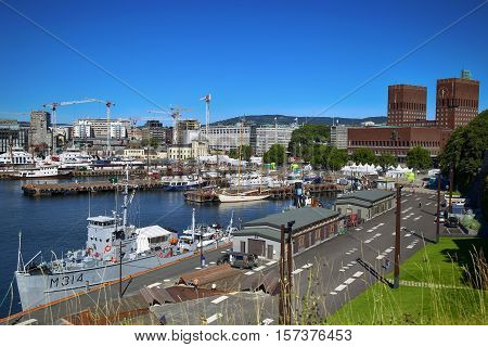 OSLO NORWAY - AUGUST 17 2016: View of panorama on Oslo Harbour and Oslo City Hall from Akershus fortress in Oslo Norway on August 17 2016.