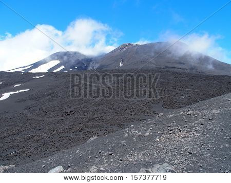 Abandoned fuming Etna crater in spring, the tallest active volcano in Europe, Sicily, Italy