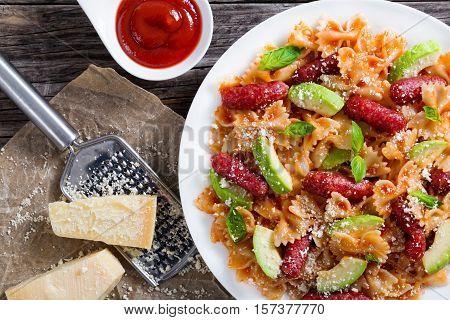 Sausages Bowtie Pasta Warm Salad With Avocado Slices