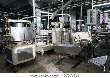 Outdated machine equipment of fish canning factory
