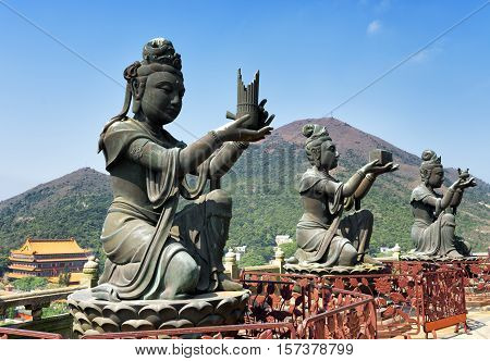 Buddhist Statues Praising And Making Offerings To The Tian Tan Buddha In Hong Kong