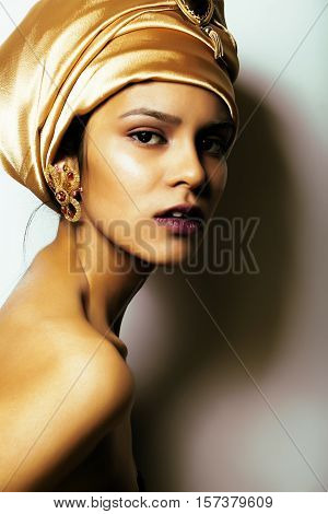 beauty african woman in shawl on head, very elegant look with gold jewelry close up mulatto dark afro asian