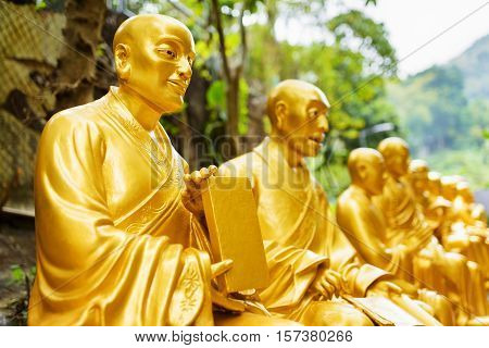 Golden Buddha Statues Along The Stairs Leading To The Ten Thousand Buddhas Monastery