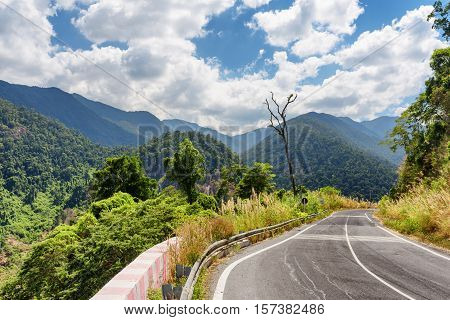 Bend Of Road And A Beautiful View Of The Mountains Around Da Lat City (dalat) On Sky Background In V