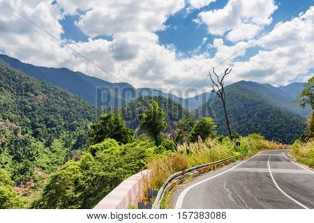 Bend Of Road And A View Of The Mountains Around Da Lat City (dalat) On Beautiful Sky Background In V