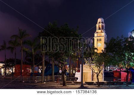 View of the Clock Tower in Hong Kong at evening former Kowloon-Canton Railway Clock Tower. Hong Kong is popular tourist destination of Asia and leading financial centre of the world.