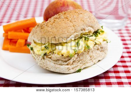 egg and cress roll with apple, crisps and a glass of water