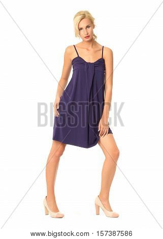 Full Length Of Flirtatious Woman In Blue Dress Isolated On White