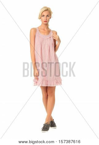 Portrait Of Flirtatious Woman In Pink Summer Dress Isolated On White