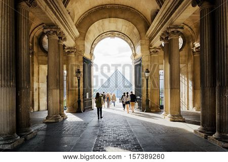The View Of The Pyramid Of The Louvre Through The Gate Sully In Paris, France.
