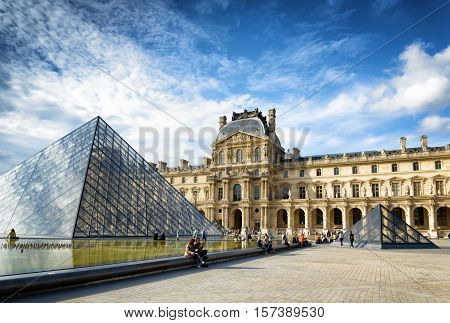 The View Of The Passage Richelieu And The Pyramid Of The Louvre In Paris.