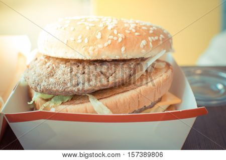 Hamburger In White Paper Box In Fast Food
