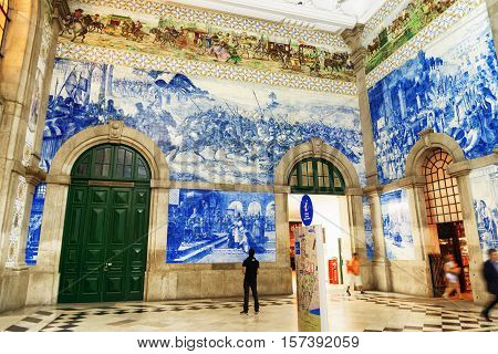 Azulejo Panels On Walls Of Main Hall Inside Of The Sao Bento Railway Station In Porto City