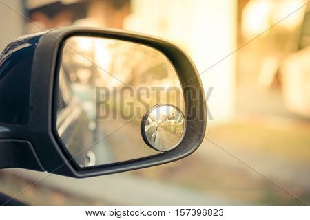 Car side mirror for rear view with traffic reflection background process in vintage style