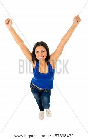 young happy attractive hispanic woman in casual top and jeans doing victory sign posing excited and cheerful isolated on white background