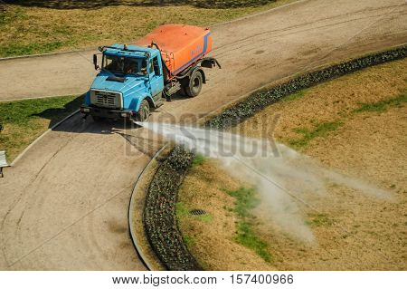 Saint-Petersburg, Russia - May 15, 2006: Large truck pulling a water tank spraying for watering of bed near Isaakievsky cathedral