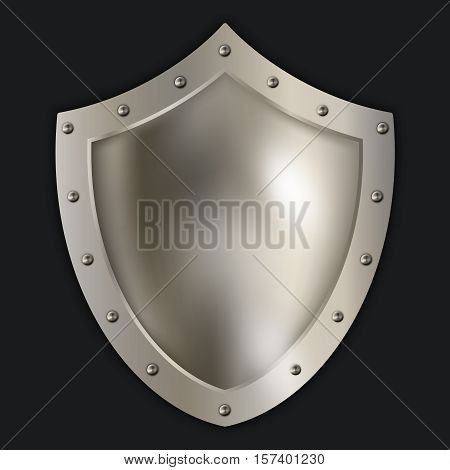 Antique riveted shield on black background. Isolated object for the design.