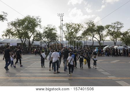 BANGKOK THAILAND - OCT 23 : A crowd of mourners on Ratchadamnoen Nai road in Sanam Luang area while the funeral of king Bhumibol Adulyadej in Grand Palace on october 23 2016
