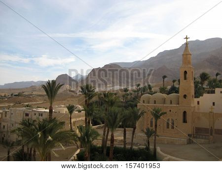 photo of a landscape with a prospect of mountains, sky and buildings the oldest Christian monastery of St. Anthony the Great in Egypt for print and design