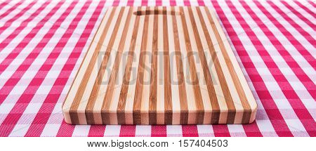 woden cutting board on a kitchen table