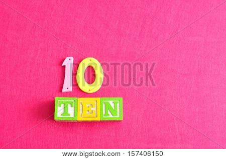 Number 10 displayed as a word and a number